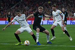 December 13, 2018 - Seville, Andalucia, Spain - Sergio Escudero of Sevilla FC and Gazinski of Krasnodar fight for the ball during the Europa League match between Sevilla FC and Krasnodar in Ramón Sánchez Pizjuán Stadium (Seville) (Credit Image: © Javier MontañO/Pacific Press via ZUMA Wire)