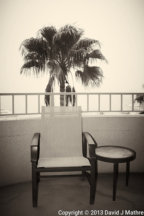 Chair on the Balcony in the Early Morning Fog at the Vinoy Hotel in St. Petersburg, Florida. Image taken with a Nikon 1 V1 camera and 10 mm f/2.8 lens (ISO 100, 10 mm, f/4.5, 1/250 sec). Raw image processed with Capture One 7 Pro (including conversion to B&W).