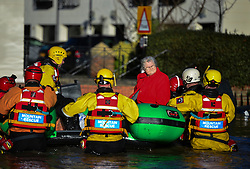 © Licensed to London News Pictures. 27/12/2015. York, UK.  An elderly woman being rescued from her home by Mountain Rescue. . Large areas of the North of England have been hit by severe flooding following unusually heavy rainfall in December. Photo credit: Ben Cawthra/LNP