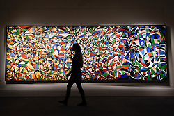 """© Licensed to London News Pictures. 21/04/2017. London, UK.  A staff member walks in front of """"Towards a Sky"""", 1953, by Fahrelnissa Zeid (Est. GBP 550-650k), at a preview at Sotheby's, New Bond Street, of upcoming sales of Arts of the Islamic World, 20th century Middle East Art and Orientalist art. Photo credit : Stephen Chung/LNP"""