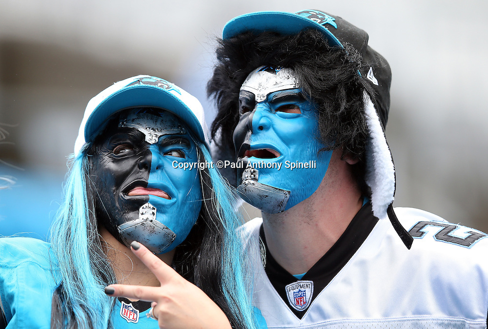 A pair of Carolina Panthers fans wear team colored scary face masks during the 2015 NFL week 3 regular season football game against the New Orleans Saints on Sunday, Sept. 27, 2015 in Charlotte, N.C. The Panthers won the game 27-22. (©Paul Anthony Spinelli)