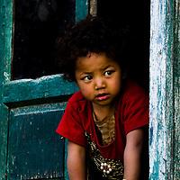 Inquisitive child from a window at Turtuk Village.