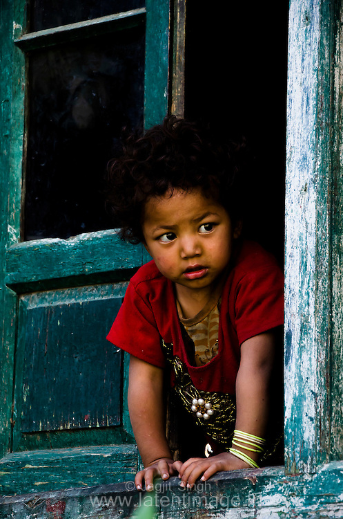 Inquisitive child from a window at Turtuk Village.
