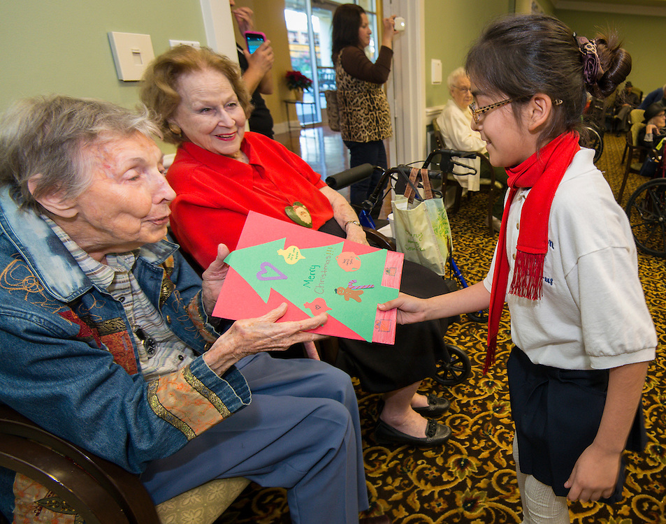 Students from Sutton Elementary School present a holiday performance for residents of the Clarewood House retirement and Assisted Living Facility, December 16, 2013.