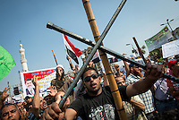 "Morsi and Muslim Brotherhood supporters armed themselves with clubs and metal bars, they said for ""protection"" against rival protesters."
