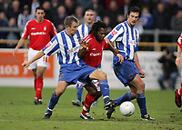 Photo: Paul Thomas.<br /> Chester City v Nottingham Forest. The FA Cup.<br /> 03/12/2005.<br /> <br /> Forest's David Johnson takes on Tom Curtis and Stewart Drummond.