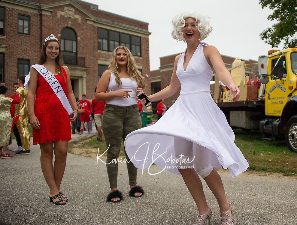 """Marilyn Monroe (Rhyan Kirk) brings a flash of star power to the senior's """"Hollywood"""" float during LHS Homecoming Friday afternoon.  (Karen Bobotas/for the Laconia Daily Sun)"""