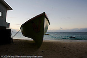 colorful work boats on the beach near Hotel California at sunset at the beach in Grand Case