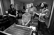 Jenny Marie Keris, from left, Jaime Sego, Jeff Pruett and Albert Rothstein review a track recorded Saturday in Florence during a recording session for Keris' debut album. Sego and Rothstein are two emerging sound engineers in the Shoals. Keris is a transplant to the Shoals that has come to fully appreciate what the area has to offer for musicians. Pruett plays ukulele for various bands in the Shoals.