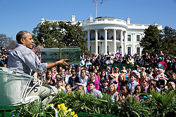 "President Barack Obama reads ""Where the Wild Things Are"" by Maurice Sendak to children during the annual Easter Egg Roll on the South Lawn of the White House, April 6, 2015. (Official White House Photo by Pete Souza)<br /> <br /> This official White House photograph is being made available only for publication by news organizations and/or for personal use printing by the subject(s) of the photograph. The photograph may not be manipulated in any way and may not be used in commercial or political materials, advertisements, emails, products, promotions that in any way suggests approval or endorsement of the President, the First Family, or the White House."