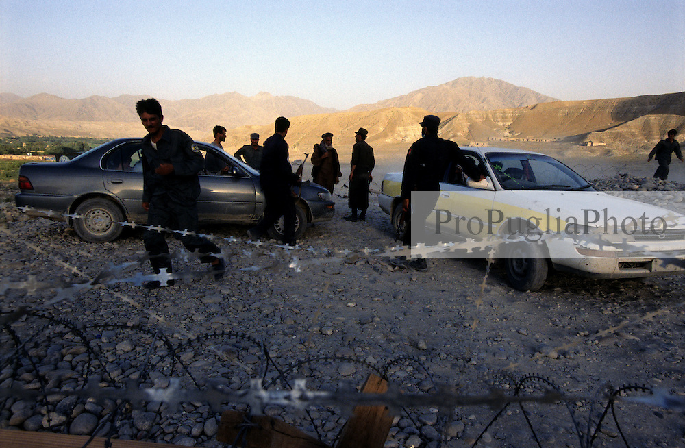 Somewhere in Afghanistan, 15 July 2005..On the road from Turkham to Kabul, drivers are stopped at a military checkpoint.