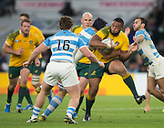Twickenham. Great Britain,  Australian prop, Sekope KEPU, run is stopped a by a combined Argentine defence, during, Semi Final. Australia vs Argentina  2015 Rugby World Cup,  Venue, Twickenham Stadium, Surrey England.   Sunday  25/10/2015   [Mandatory Credit; Peter Spurrier/Intersport-images]