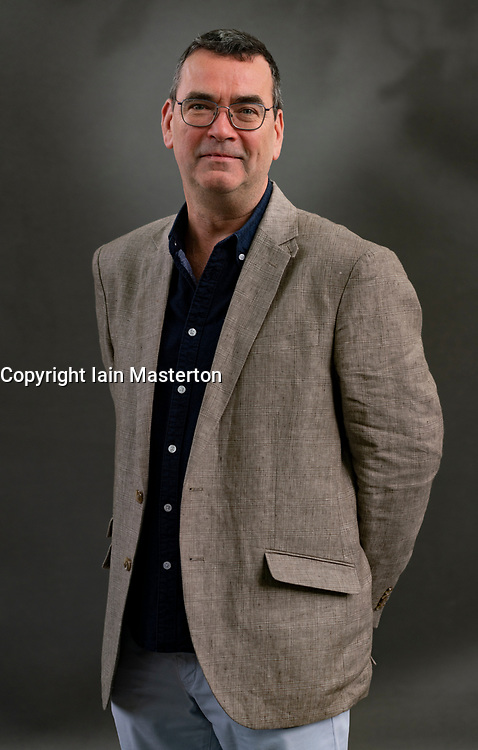 Edinburgh, Scotland, UK. 21 August 2019. Mick Herron. Award winning crime novelist Mick Herron unleashes his sixth Jackson Lamb thriller Joe Country in which the British espionage game is cranked up a deadly notch. Iain Masterton/Alamy Live News.