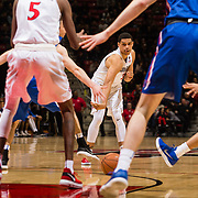 27 February 2018: San Diego State men's basketball hosts Boise State in their last meet up of the regular season at Viejas Arena. San Diego State Aztecs guard Trey Kell (3) threads the ball through the Boise State defense to teammate Jalen McDaniels (5) in the second half. The Aztecs beat the Broncos 72-64.  <br /> More game action at sdsuaztecphotos.com