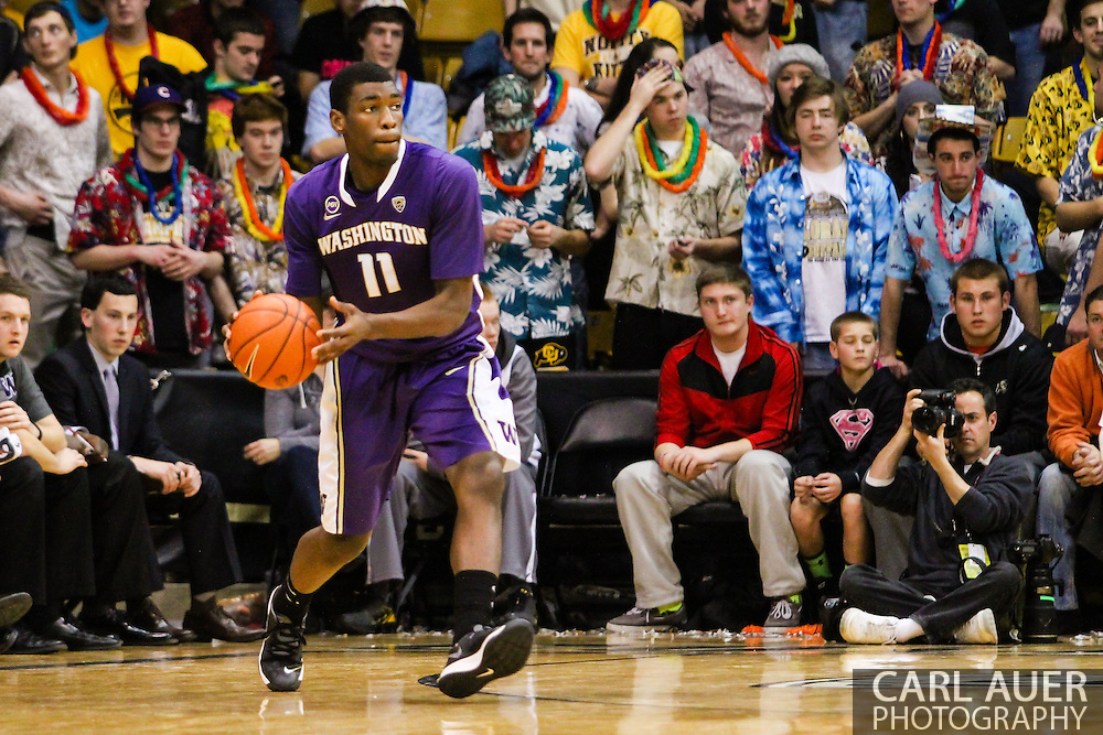 February 9th, 2014:  Washington Huskies junior guard Mike Anderson (11) passes the ball during the second half of the NCAA Basketball game between the Washington Huskies and the University of Colorado Buffaloes at the Coors Events Center in Boulder, Colorado