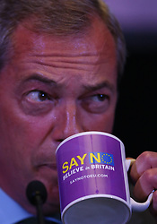 © Licensed to London News Pictures. 04/09/2015. London, UK. United Kingdom Independence Party (UKIP) leader Nigel Farage drinks from a 'SAY NO' campaign mug as launches his 'Say No to EU referendum' tour and campaign. Photo credit: Peter Macdiarmid/LNP