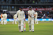 Bad light stops play - Jonny Bairstow of England and Ben Stokes of England walk back to the pavilion after bad light stops play during the International Test Match 2019, fourth test, day three match between England and Australia at Old Trafford, Manchester, England on 6 September 2019.