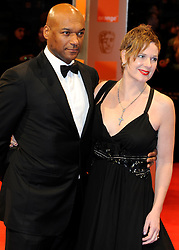 ©London News Pictures. 13/02/2011. Actor Colin Salmon and wife Fiona Hawthorne  Arriving at BAFTA Awards Ceremony Royal Opera House Covent Garden London on 13/02/2011. Photo credit should read: Peter Webb/London News Pictures