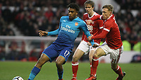 Alex Iwobi does his best to hold off Ben Osborn  during The Emirates FA Cup Third Round match between Nottingham Forest and Arsenal at City Ground on January 7, 2018 in Nottingham, England.