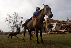 Hurricane Rita - America's forgotten Hurricane.<br />25th Sept, 2005. Hurricane Rita aftermath, Lake Calcasieu shipping canal close to Cameron, Louisiana one day after the storm smashed the coastline. Local man Aaron Stokes befriends a horse cut loose ahead of the storm.