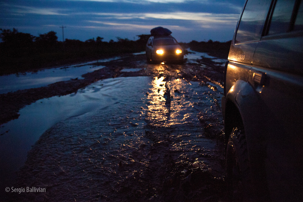 The view from a 4x4 heading into the pampas of the Beni region at night and during the rainy season in Bolivia.  Mud and water abound.