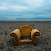 "Armchair washed up on Dollymount Strand, Bull Island, Dublin, February 2009. While this image is instantly symbolic of out throwaway Western culture, it also speaks of how some of us in the west have lapsed into the luxurious idea that we're doing enough to save the environment. We  might eat less meat, drive less, take less flights, recycle, vote Green, and change our lightbulbs, but as we sit smugly in our middle class armchairs, we should realise that despite our actions, sea levels are rising, and a ""trash vortex"" is now forming in the Atlantic Ocean. Are we really doing enough?This image is from an ongoing, long term photography project, on the use AND misuse of Bull Island, a 200 year old island, sandback and UNESCO Biosphere at the north end of Dublin Bay, Ireland. This collection plans to cover the wildlife - both human and other, and challenge the misuse of an elaborate ecosystem on the edge of Dublin city."