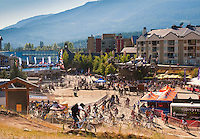 Whistler Village bustles with activity and visitors during the Crankworx summer festival as mountain bikers ride the trails down the mountain.