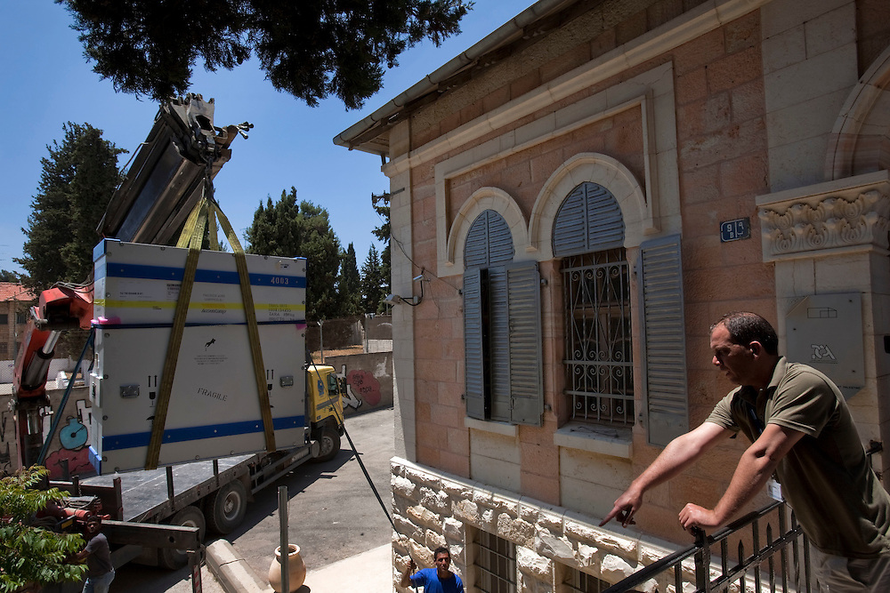 Workers move the Picasso paint to to the International Academy of Art of Palestine on June 19, 2011 in Ramallah...Photo by Olivier Fitoussi / Die Zeit