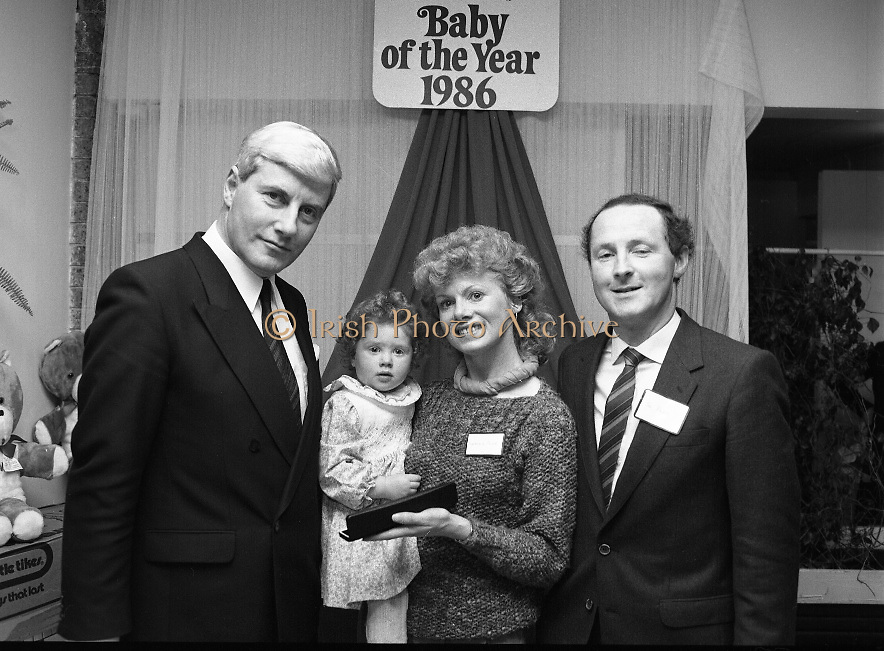 Heinz / Woman's Way, Baby of the Year..1986..21.11.1986..11.21.1986..21st November 1986..The 19th Annual 'Baby of the Year' awards ceremony took place at the Zoological Gardens,Dublin..Baby, Alan Smith from Co Meath was the overall winner.Amy Dempsey from Dublin and Brendan Gallagher from Waterford were placed 2nd and 3rd...Image of the Munster Regional winner Maria-Edel Power with her mother and father,Fionnuala and Joe from Ennis,Co Clare, accepting the award from Mr John Paul O'Connor of Heinz.