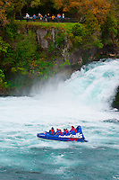 Huka Jet (jet boat) with Huka Falls in background, near Taupo, North Island, New Zealand