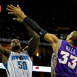 February 2, 2012; New Orleans, LA, USA; New Orleans Hornets center Emeka Okafor (50) shoots over Phoenix Suns small forward Grant Hill (33) during the second quarter of a game at the New Orleans Arena.   Mandatory Credit: Derick E. Hingle-US PRESSWIRE