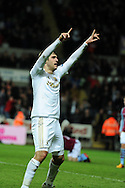Swansea city's Danny Graham ® celebrates after he scores his sides 2nd to make it 2-2.   Barclays Premier league, Swansea city v Aston Villa at the Liberty Stadium in Swansea, South Wales on New Years Day, Tuesday 1st Jan 2013. pic by Andrew Orchard, Andrew Orchard sports photography,