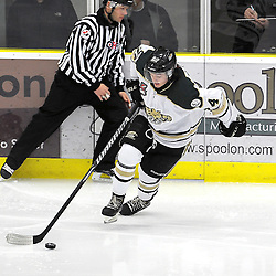COBOURG, ON - Dec 23 : Ontario Junior Hockey League Game Action between the Cobourg Cougars and the Buffalo Jr. Sabres, Taylor Gauld #24 of the Cobourg Cougars Hockey Club skates with the puck during second period game action. <br /> (Photo by Andy Corneau / OJHL Images)