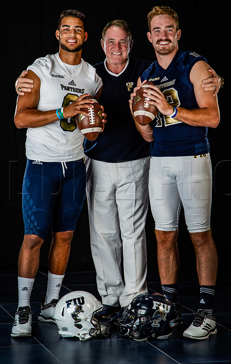 Butch Davis with quarterbacks Christian Alexander and James Morgan as they pose for a photograph at 	Riccardo Silva Stadium on Wednesday, August 8, 2018.