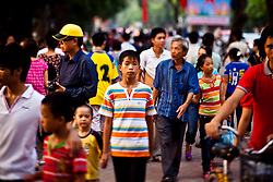 Crowd walking around Hoan Kiem lake, Hanoi, Vietnam, Southeast Asia.