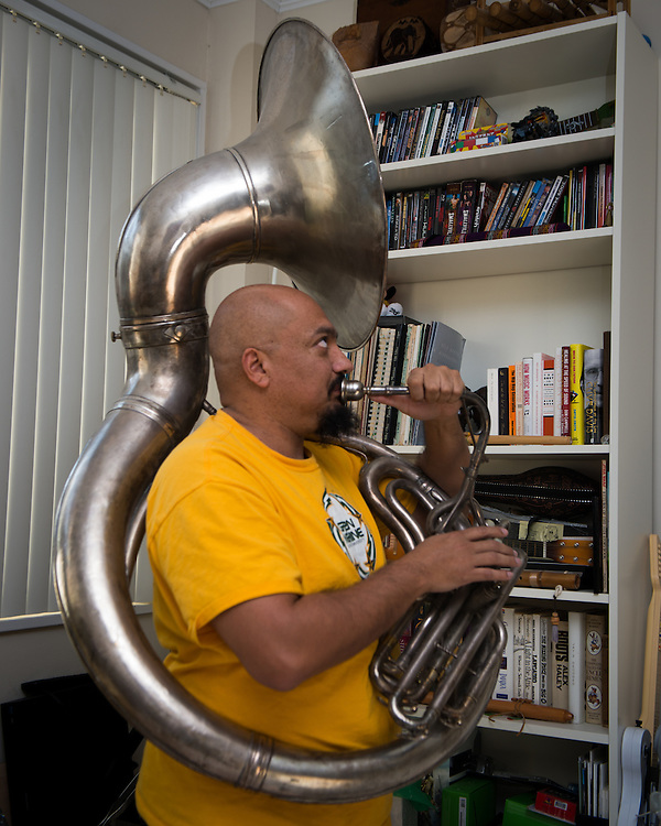 December 5, 2015 - Fairfax, VA - A day in the life of &quot;Doc Nix,&quot; aka Dr. Michael Nickens, the Director of the Athletic Bands for George Mason University. Back home before preparing for the game Doc Nix takes a time out to play a riff on the tuba.<br /> <br /> <br /> Photo by Susana Raab