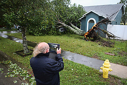 October 7, 2016 - Titusville, Florida, U.S. - WILL VRAGOVIC   |   Times.John Shea, 69, photographs the tree that uprooted in the winds of Hurricane Matthew and landed on his Ford pickup truck in front of his home in Titusville, Fla. on Friday, Oct. 7, 2016. (Credit Image: © Will Vragovic/Tampa Bay Times via ZUMA Wire)