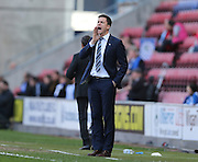 Wigan Athletic manager Gary Caldwell during the Sky Bet Championship match between Wigan Athletic and Brighton and Hove Albion at the DW Stadium, Wigan, England on 18 April 2015.