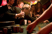 Placing bets on a table in The Lost Vagueness casino at the Glastonbury festival. Enter into the theatre of glitzy sleaze in this decadent den of pure wickedness. With Blackjack and Roulette on the tables and chips exchangeable for drinks, this fun casino is the definitive playground for those that love to play.