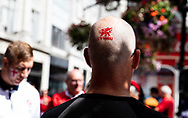 A Wales fab has face paint applied to the back of his head<br /> <br /> Photographer Simon King/Replay Images<br /> <br /> Friendly - Wales v England - Saturday 17th August 2019 - Principality Stadium - Cardiff<br /> <br /> World Copyright © Replay Images . All rights reserved. info@replayimages.co.uk - http://replayimages.co.uk