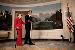 President Barack Obama escorts former First Lady Nancy Reagan in the Diplomatic Room of the White House June 2, 2009, for the announcement and signing of the Ronald Reagan Centennial Commission Act--commemorating the late President's 100th Birthday in 2011. (Official White House Photo by Lawrence Jackson), This official White House photograph is being made available for publication by news organizations and, or for personal use printing by the subject(s) of the photograph. The photograph may not be manipulated in any way or used in materials, advertisements, products, or promotions that in any way suggest approval or endorsement of the President, the First Family, or the White House.Ê. EXPA Pictures © 2016, PhotoCredit: EXPA/ Photoshot/ Lawrence Jackson<br /> <br /> *****ATTENTION - for AUT, SLO, CRO, SRB, BIH, MAZ, SUI only*****