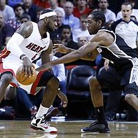 17 January 2012: Miami Heat small forward LeBron James (6) dribbles against San Antonio Spurs small forward Kawhi Leonard (2) during the Miami Heat 120-98 victory over the San Antonio Spurs at the AmericanAirlines Arena, Miami, Florida, USA.