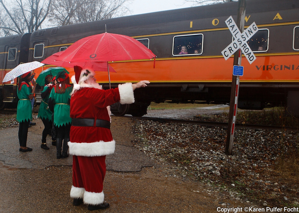 "Santa Claus and his ""elves"" wave at A special Polar Express  train as it pulls into rural Pope, Miss. (disguised as the North Pole) on Sunday.  Pajama-clad children and their parents took the special train on an hour long trip, departing from Batesville. Passengers listened to a recording of the Polar Express book, read by the author. About 3,000 rode the train over the weekend. The train is run by the Iowa Pacific, which recently took over the ex-Illinois Central line between Memphis and Jackson. The train runs various times through December 27th. This is the first time the train has come to Mississippi."