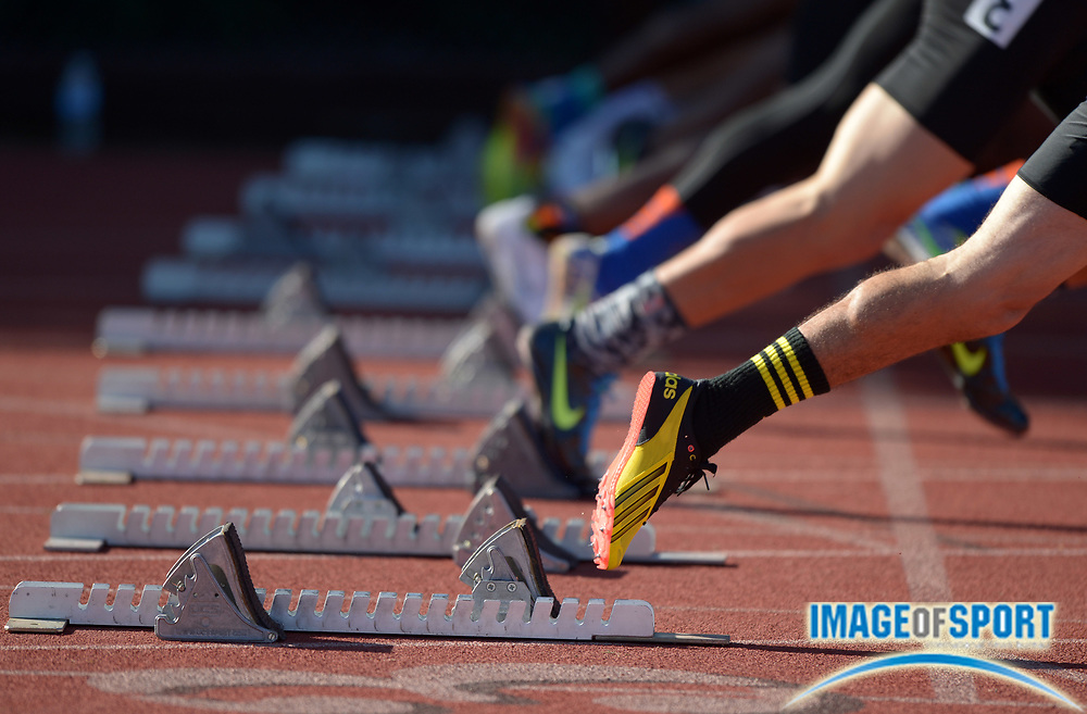 Apr 5, 2014; Stanford, CA, USA; General view of sprinters in the starting blocks of the boys 100m final in the 2014 Stanford Invitational at Cobb Track & Angell  Field.