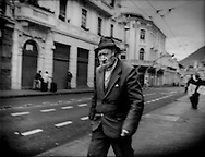 Man makes his way through the historical old city of Quito, which is an UNESCO World Heritage Site.  Ecuador.