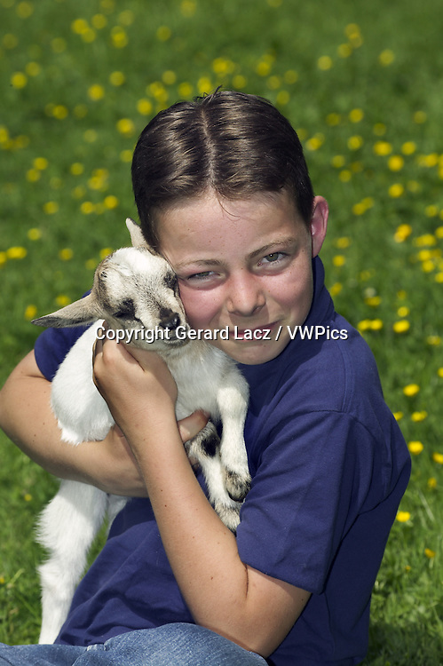 Boy with Pigmy Goat in his Arms