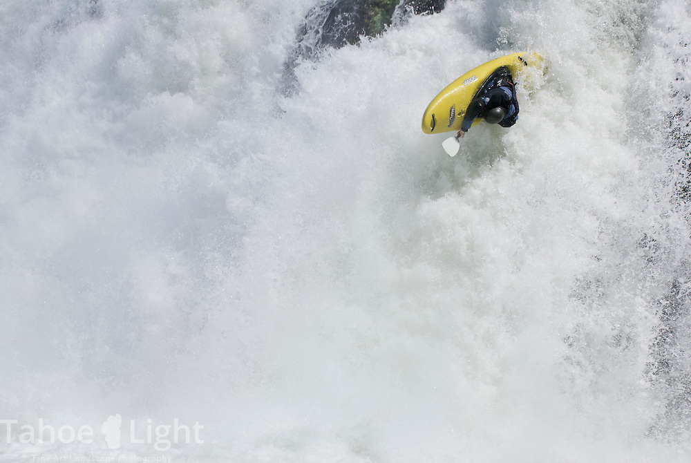 Kayaker Clint Monfalcone gets upside down on his attempt at the pit falls during the pit river release august 19, 2007. Model release available..