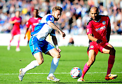Bristol Rovers' Matty Taylor is challenged by Dover Athletic's Richard Orlu - Photo mandatory by-line: Neil Brookman - Mobile: 07966 386802 - 04/10/2014 - SPORT - Football - Bristol - Memorial Stadium - Bristol Rovers v Dover - Vanarama Football Conference