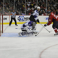 05 February 2009:  Los Angeles Kings goalie Jonathan Quick (32) makes  a save on a shot by Washington Capitals center Brooks Laich (21) at the Verizon Center in Washington, D.C.  The Kings defeated the Capitals 5-4 as Alex Ovechkin recorded his 200th NHL goal in the game.