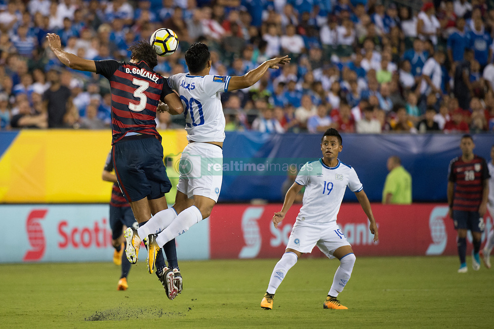 July 19, 2017 - Philadelphia, Pennsylvania, U.S - United States of America defender  OMAR GONZALEZ (3) wins a header against El Salvador defender HAROLD ALAS (20) while El Salvador defender EDWIN SçNCHEZ (19) look on during CONCACAF Gold Cup 2017 quarterfinal action at Lincoln Financial Field in Philadelphia, PA.  USA  defeats El Salvador 2 to 0. (Credit Image: © Mark Smith via ZUMA Wire)